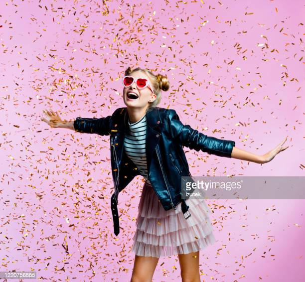 beautiful teenege girl among gold confetti - embellished jacket stock pictures, royalty-free photos & images