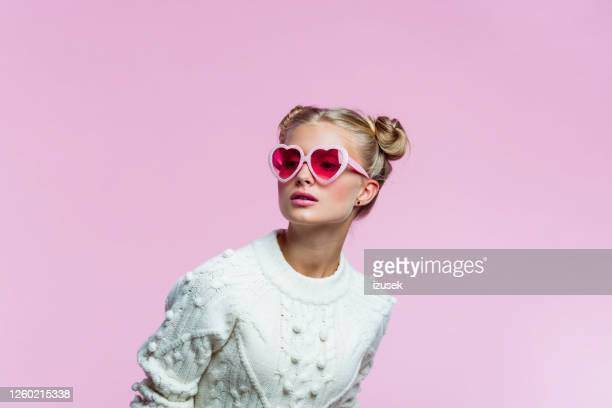 beautiful teenege girl wearing heart shaped sunglasses - sunglasses stock pictures, royalty-free photos & images