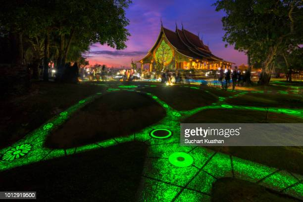 beautiful temple, wat phu prao, glows in the dark from luminescent paint. - phosphorescence stock pictures, royalty-free photos & images