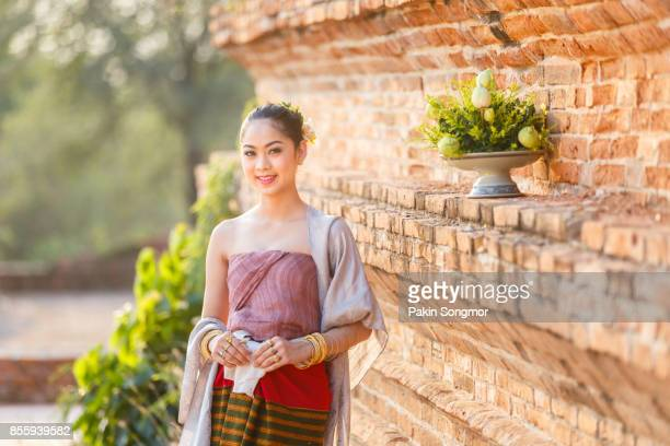 Beautiful Thai girls in thai traditional costume at old temple, Ayutthaya Province, Thailand