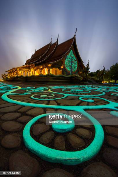 beautiful thai temple glows in the dark from luminescent paint, sirindhorn wararam phu prao temple (wat phu prao). - phosphorescence stock pictures, royalty-free photos & images