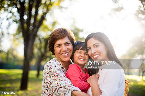 beautiful three generation family - multigenerational family stock photos and pictures