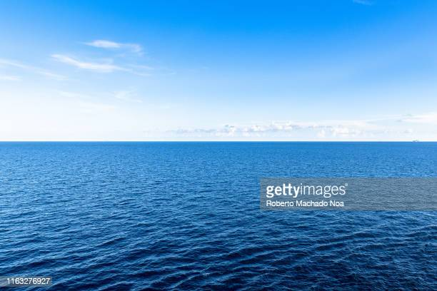 Beautiful tones of blue colors seen in the Atlantic Ocean. The image shows the horizon over water. Below, a deep blue color sea. Above, a light blue...