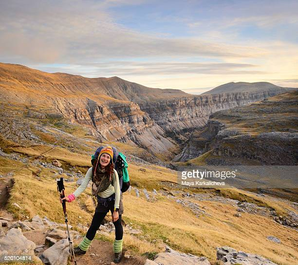 Beautiful tourist with a canyon on the background, Ordesa, Pyrenees