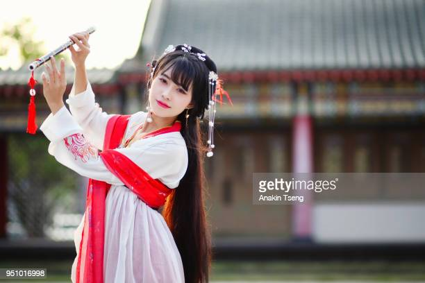 beautiful traditional chinese lady - 1 - bamboo flute stock photos and pictures