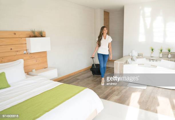 beautiful traveling woman entering her room at the hotel - hotel room stock pictures, royalty-free photos & images