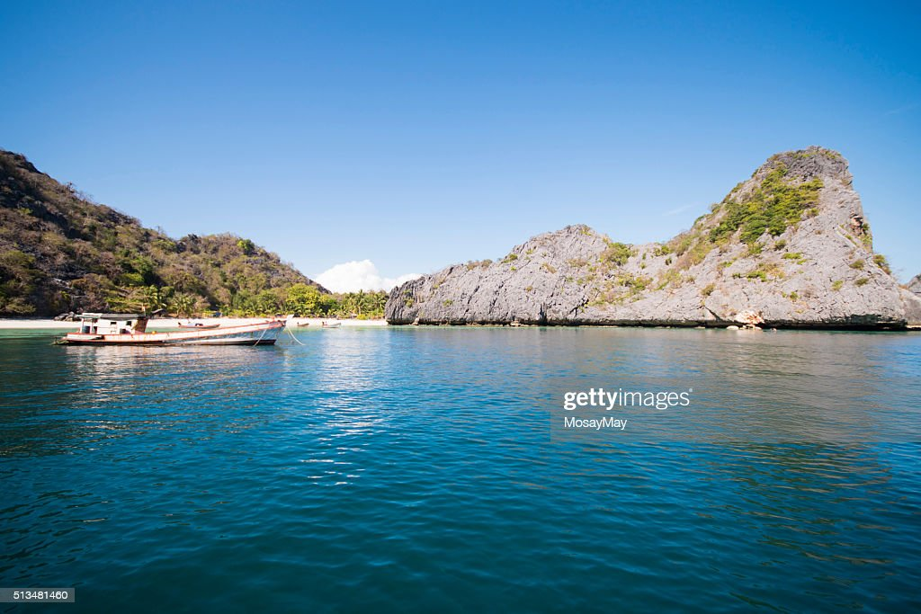 Beautiful Tropical Island With Fishing Boat Stock Photo