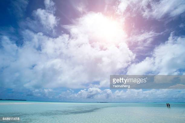 beautiful tropical landscape. people walking on a beach