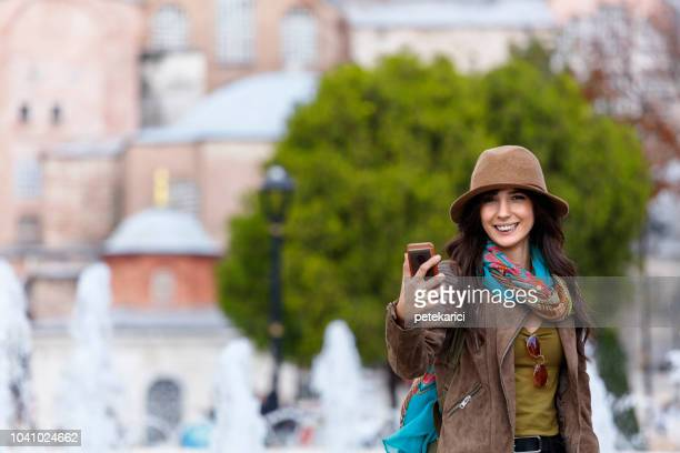 Beautiful Turkish girl making a selfie nearby The Hagia Sophia