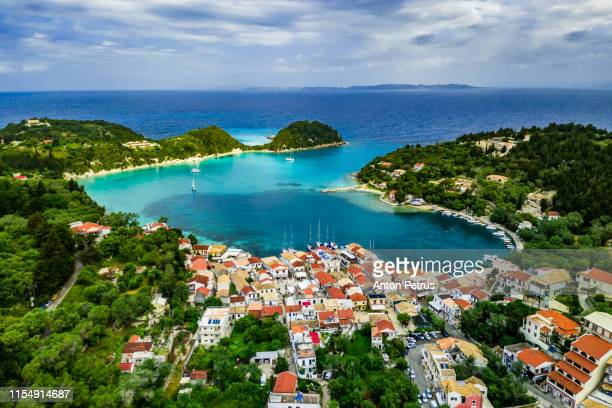 beautiful turquoise bay in lakka. paxos. ionian islands of greece. - corfu stock pictures, royalty-free photos & images