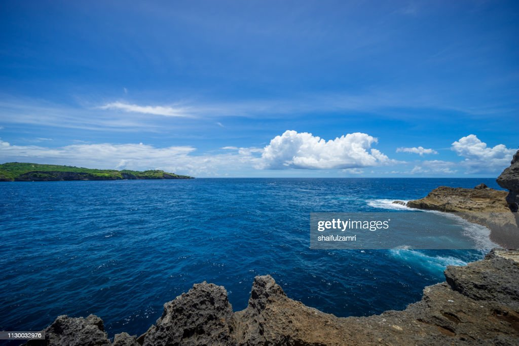 Beautiful turquoise beach with big waves and crystal clear water in Nusa Penida in Bali, Indonesia. : Stock Photo
