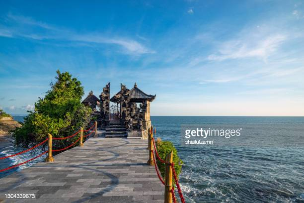 beautiful turquoise beach with old temple and crystal clear water in bali, indonesia. - shaifulzamri stock pictures, royalty-free photos & images