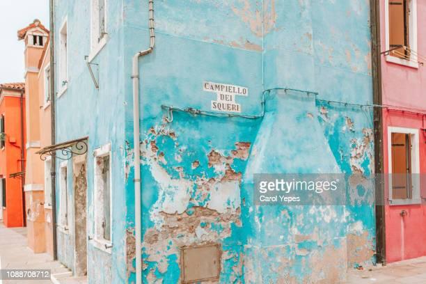 beautiful  turquoise burano street, italy - burano foto e immagini stock