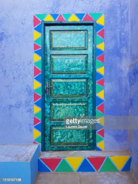 a beautiful turquoise door with a multi-colored painting in a nubian village near aswan, egypt - nubia stock pictures, royalty-free photos & images