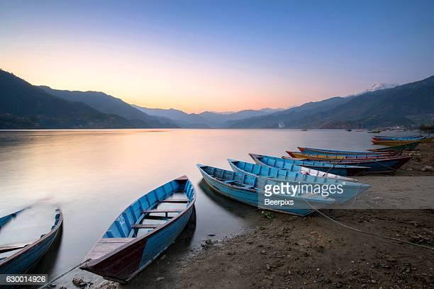 Beautiful twilight landscape with boats on Phewa lake, Pokhara, Nepal.