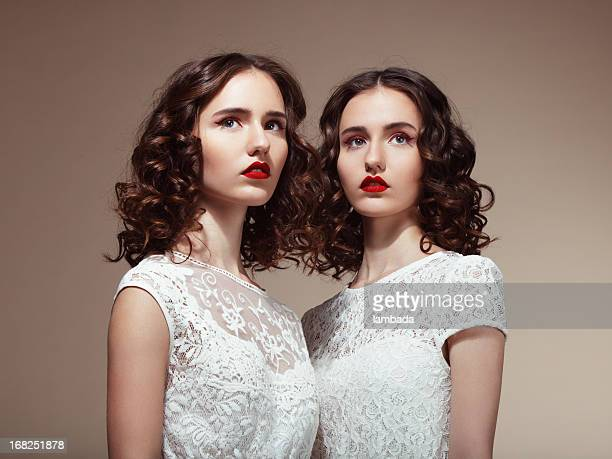 beautiful twins - lace dress stock pictures, royalty-free photos & images