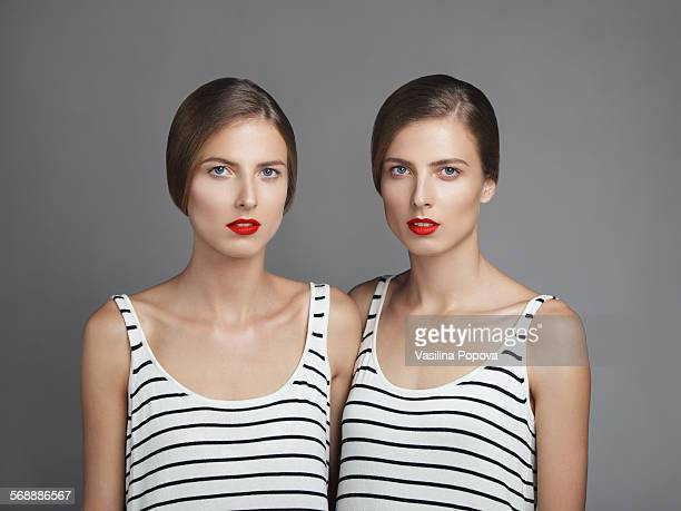 beautiful twins - striped dress stock photos and pictures
