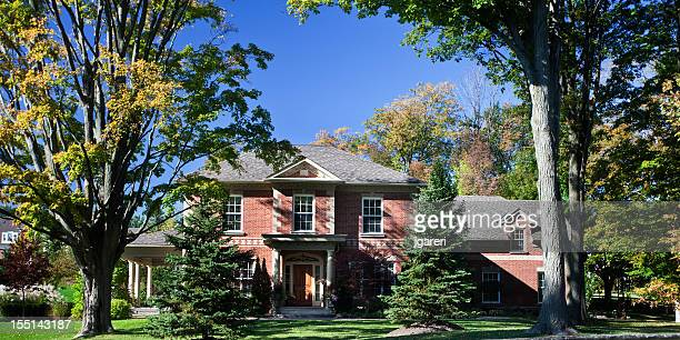 a beautiful two story estate home. - stone house stock pictures, royalty-free photos & images