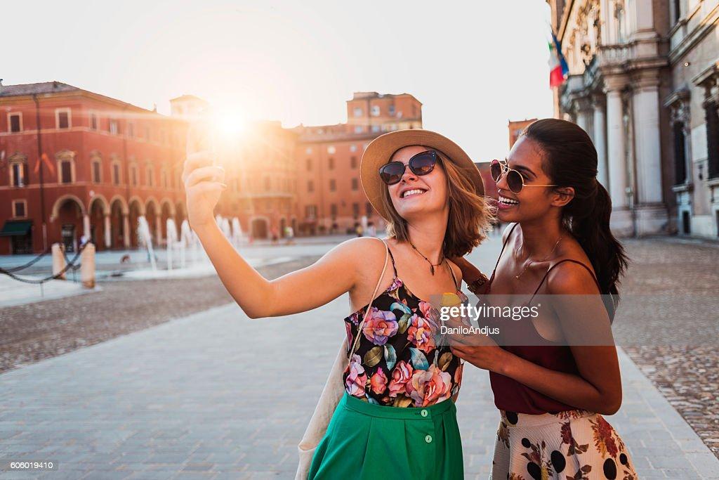 beautiful two young women taking a selfie : Stock Photo