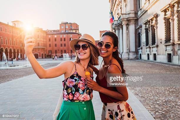 beautiful two young women taking a selfie - spain italy stock pictures, royalty-free photos & images