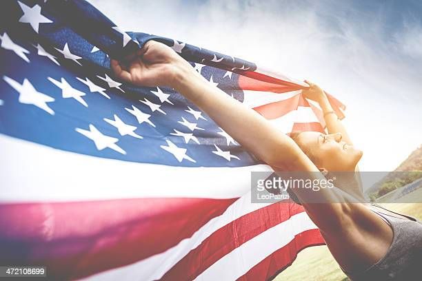 beautiful us athlete with national flag - patriotic stock pictures, royalty-free photos & images