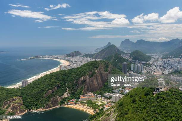 beautiful view from sugar loaf cable car to green rainforest mountains - brazil stock pictures, royalty-free photos & images