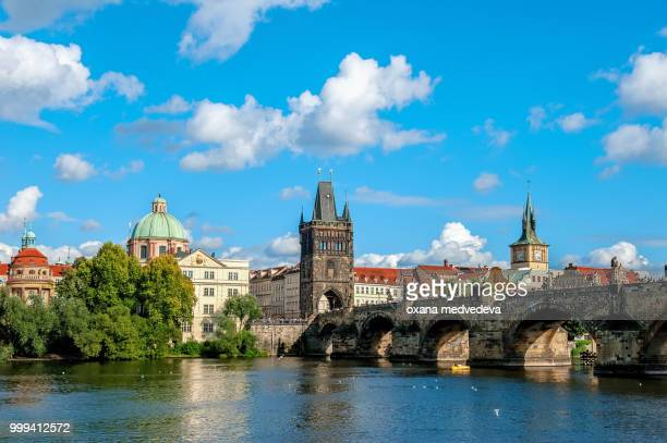 Beautiful view from the river Vltava on the Bank of Prague on a Sunny day with a dramatic sky.