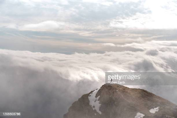 beautiful view from the top of a mountain a woman looking at the awesome cloud scape from above - レオン県 ストックフォトと画像