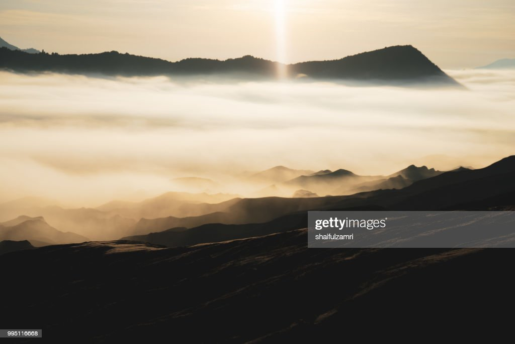 Beautiful view landscape of active volcano crater with morning fog at Mt. Bromo, East Java, Indonesia. : Stock Photo