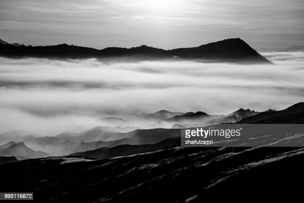 Beautiful view landscape of active volcano crater with morning fog at Mt. Bromo, East Java, Indonesia.