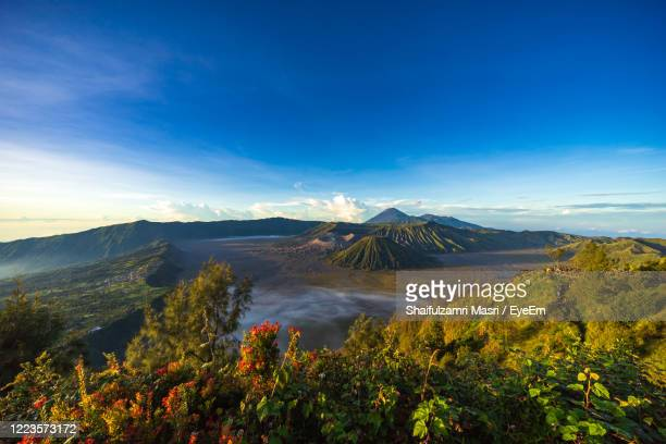 beautiful view landscape of active volcano crater with smoke at mt. bromo, east java, indonesia. - shaifulzamri eyeem ストックフォトと画像