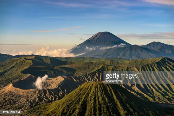 beautiful view landscape of active volcano crater with smoke at mt. bromo, east java, indonesia. - shaifulzamri stock pictures, royalty-free photos & images