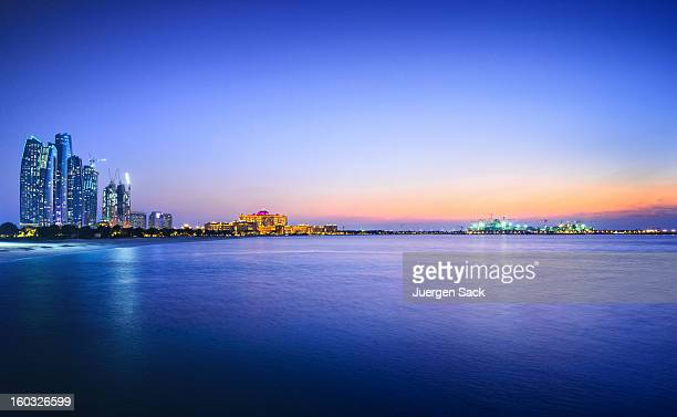 beautiful view of a city and water in abu dhabi - abu dhabi stock pictures, royalty-free photos & images