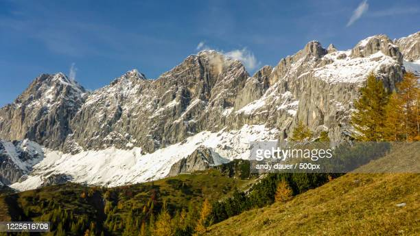 a beautiful view of a mountain range in austria, schladming, styria - schladming stock pictures, royalty-free photos & images