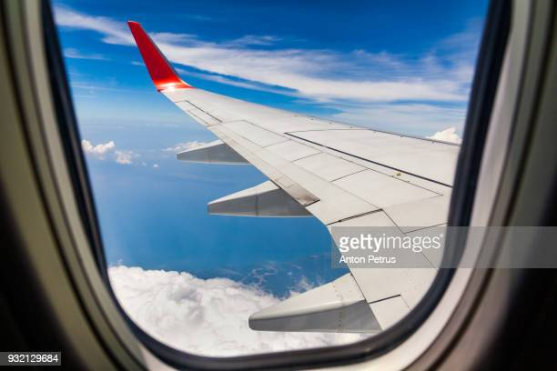 Beautiful view of  airplane wing on blue sky background