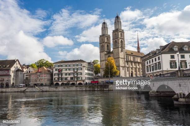 Beautiful view of Grossmünster church from across the Limmat River in Zurich
