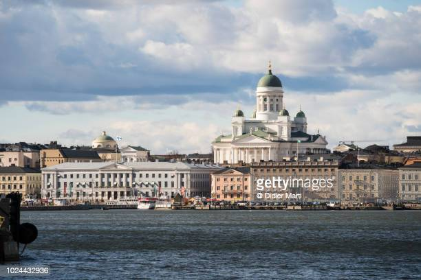 beautiful view of helsinki skyline with the famous helsinki cathedral overlooking the old town from the harbor in finland capital city. - helsinki stock pictures, royalty-free photos & images