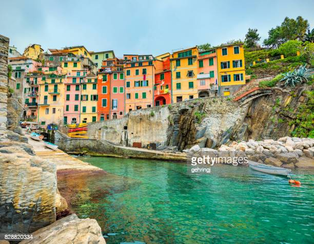 beautiful view of riomaggiore in late afternoon light. - cinque terre stock pictures, royalty-free photos & images