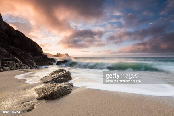 beautiful view of sunrise over sea, cornwall, uk - porthcurno stock pictures, royalty-free photos & images
