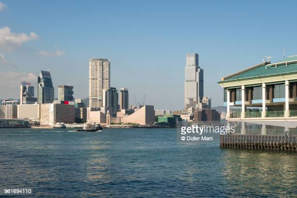 Beautiful view of the Kowloon skyline at Tsim Sha Tsui from across the Victoria harbour in Hong Kong island