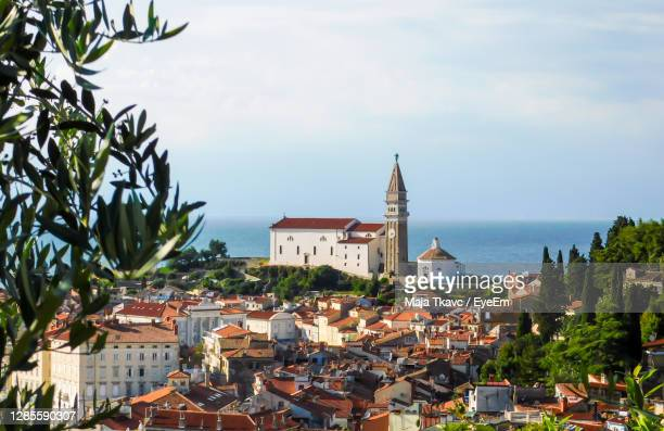 beautiful view of the old town if piran in slovenia on a sunny day - slovenia stock pictures, royalty-free photos & images
