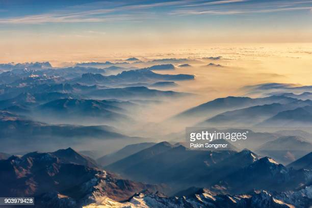 Beautiful view on the mountains from the top through the clouds