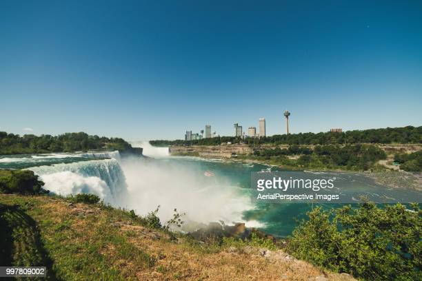 beautiful view to niagara falls during sunny day - us state border stock photos and pictures
