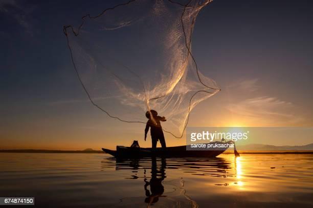 Beautiful views of Fisherman in river lifestyle sunrise.