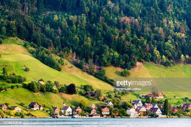 beautiful village on the shore of lucerne lake in switzerland - escarpment stock pictures, royalty-free photos & images