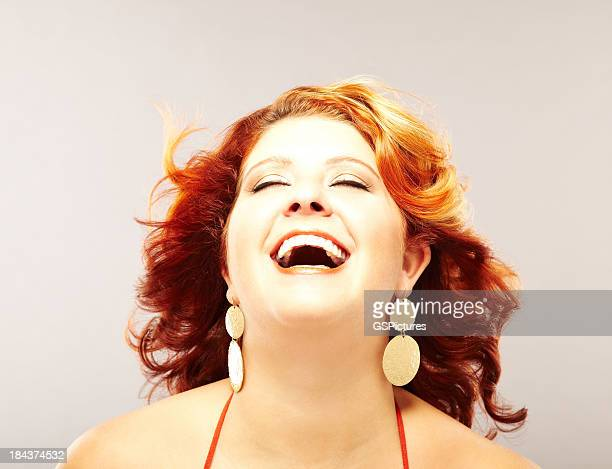 Beautiful voluptuous redhead fashion model laughing looking up