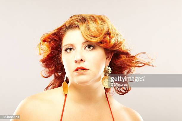 Beautiful voluptuous young female model with hair blowing