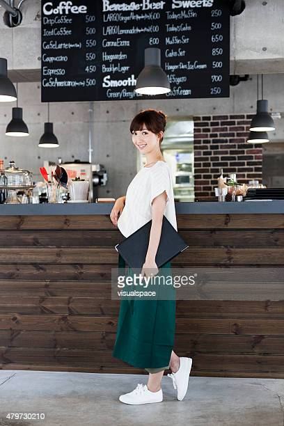 Beautiful waitress in front of a counter