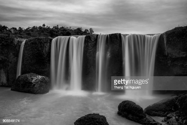 beautiful waterfall in black & white in dalat, vietnam - fast shutter speed stock photos and pictures