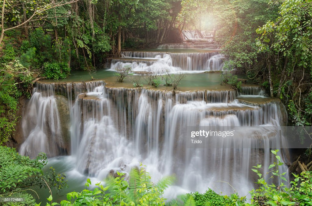 Beautiful waterfall with sun ray the forest : Stock Photo